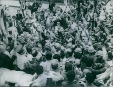 The crowd having a commotion. 1964