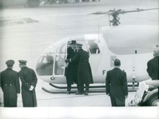 Rene Coty getting off from helicopter.