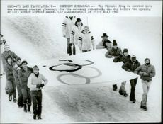The Olympic flag is brought to the Olympic Stadium at the rehearsals of the opening ceremony of the 1980 Winter Olympics