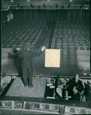 Maurice Auguste Chevalier on stage.