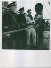 The capture crew took possession of the freighter and watched the crew as prisoners. 1940.
