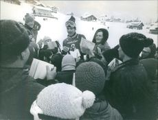 Jean-Claude Killy giving autograph to his fans.