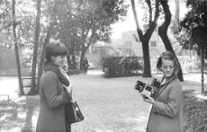 Claudia Cardinale and woman with camera.