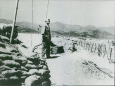 Soldier standing on a field, looking away.  Taken - 16 Mar. 1969
