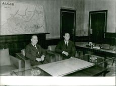 Ahmed Ben Bella sitting with a man.