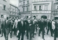 Gerald Rudolph Ford Jr walking in Warsaw with people.