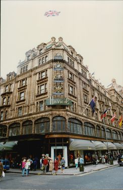 Photography at the entrance and exterior of the famous Harrods department store in London.