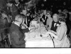 The Duke and Duchess of Windsor enjoying in a party over a dinner table.