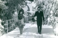 Prince Michael of Greece and his wife Marina Karella walking on snow.