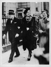 Winston Churchill walking with his wife, visits Aberdeen.