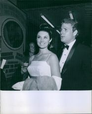 Beverly Adams with Ryan O'Neal at a party. 1966.
