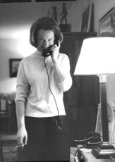 Princess Irene smiling while talking on the telephone, 1964.