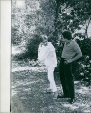 Frankie Avalon looking at Kay Diebel swing the golf club. 1963.