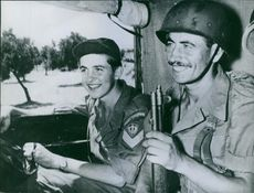 Soldiers inside a vehicle, smiling, in Greece, 1964.