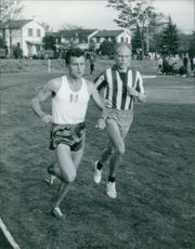 Two men running with each other.