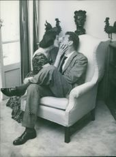 Marisa Pavan kissing her husband,  Jean-Pierre Aumont.