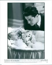 Brendan Fraser bonds with Connie's baby in Tristar Pictures' romantic comedy of mistaken identity and unexpected love, Mrs. Winterbourne.