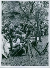 Soldiers gathered in the forest during Yugoslav Wars, 1941.