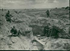 Soviet soldiers clear enemy trenches and armored shelters after Germany abandoned the front line of their defense