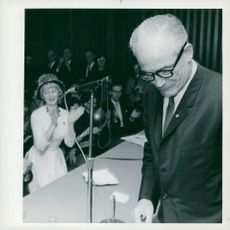 A female audience travels and applauds for one of the Arizonas host Barry Goldwater's campaign figures