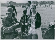 German soldiers are hosted in the Danish localities with coffee and refreshments.