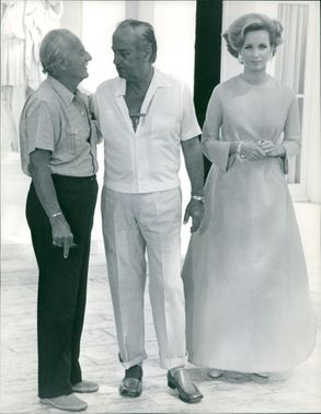 Geneviève Gilles standing with two men.