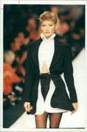Claude Montana's soft/strong message in black and white; the full-sleeved blouse and the curvy mid-thigh.