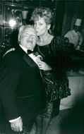 """Mickey Rooney is congratulated with a kiss of his wife Jan on the opening night of """"Sugar Babies"""""""