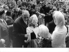 Charles de Gaulle greeted by the crowd, 1960.