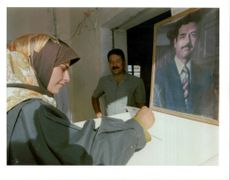 Supervisor with a portrait of saddam Hussein.