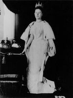 Queen Juliana standing by a table on top of which placed the Crown.