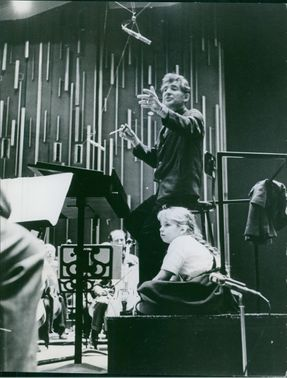 Leonard Bernstein with his daughter, Jamie Anne Maria Bernstein while he teaching a music to other people, 1964.
