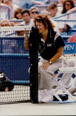 The tennis judge checks that everything looks right before the match starts at the US Open.