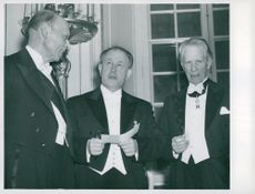 Swedish Academy's Annual High Day. Newcomer Ingvar Andersson flanked by older members Löfstedt and Siwertz