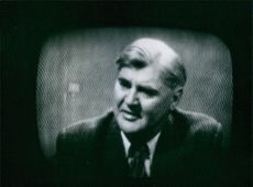 Aneurin Bevan faces the British Public. In answering questions he keeps his eyes steadily on person who posed the query.