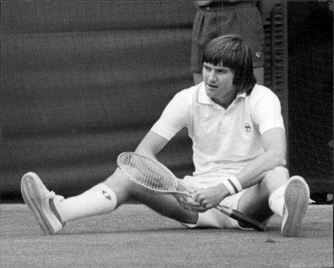 Jimmy Connors who slipped during the match against Arthur Ashe takes a little break