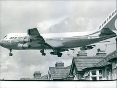 An Air India Jumbo Jet flying low over the rooftops as it comes into land at  Heathrow  Airport,London.