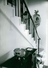 Princess Margaretha stands on the stairs while she smiles at the mirror.