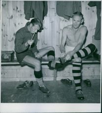 A photo of Football training players preparing themselves for the training, 1945