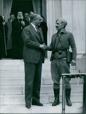 General Georgios Grivas shaking hand with a man, 1959.
