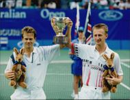 Stefan Edberg and Petr Korda proudly show up the trophy.