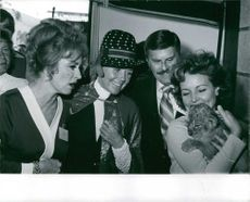 Doris Day looking at tiger puppy.