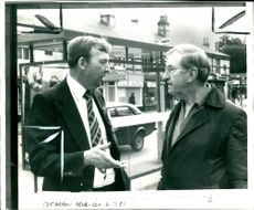 Stanley Sorrell talking to man in the street.