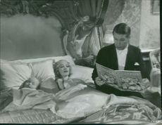 """Maurice Auguste Chevalier in a scene from Movie """" A bedtime story"""""""