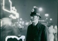 A traffic policeman standing on the road.