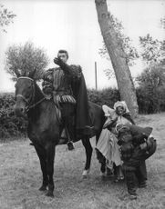 Jean-Claude Pascal on horse during a movie scene.