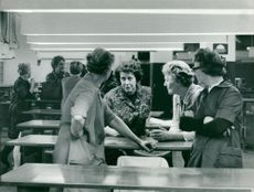 Employees gathered in the group sewing at Yllefabriken