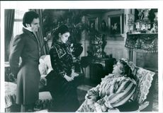 "Daniel Day-Lewis, Winona Ryder, and Miriam Margolyes on a conversation scene from the film ""The Age of Innocence.""1993"