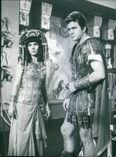 Man and woman posing on the set of a movie.
