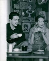 Finnish-American actress and dancer Taina Elg is having tea with her ex-husband Carl Björkenheim, while they looking at something with smiling face